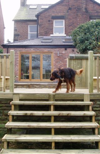 garden decking with water feature - Garden Design Cheshire